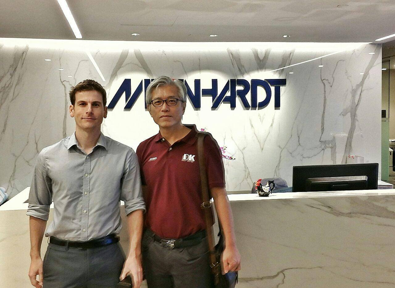 Meinhardt's representative receiving the free gift of laser distance measure