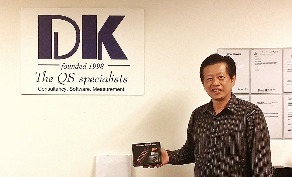 Lloyd & Andrew Builders Pte Ltd's representative with their purchase of laser distance measure.